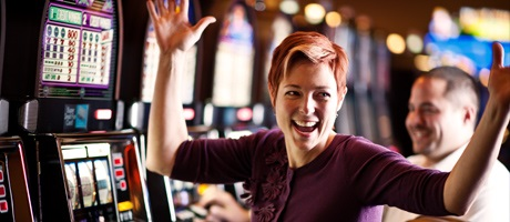 Guest celebrating big slot win a Station Casinos hotel
